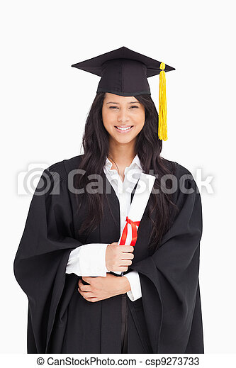 Woman with her degree dressed in her graduation gown - csp9273733