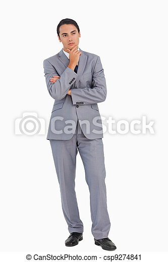 Thoughtful businessman with folded arms - csp9274841