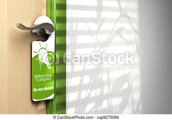 green door hanger onto a handler with room for text on the wall at the right side. On the sign it's written brilliant ideas in progress, do not disturb - csp9275084