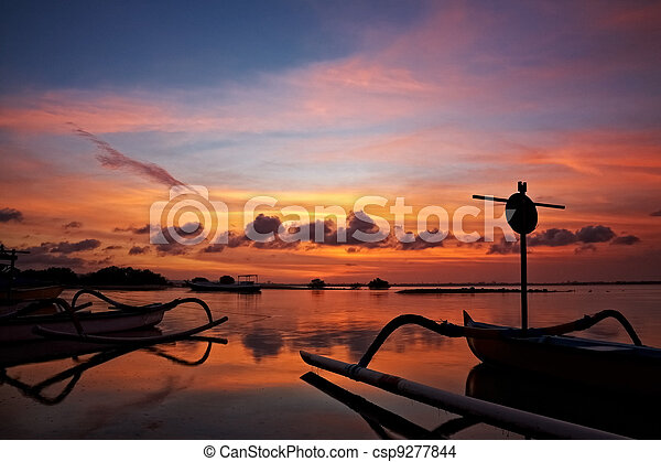 sunset over traditional fishing boats on Bali - csp9277844