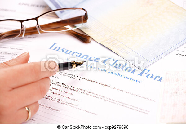 hand filling in insurance claim form - csp9279096
