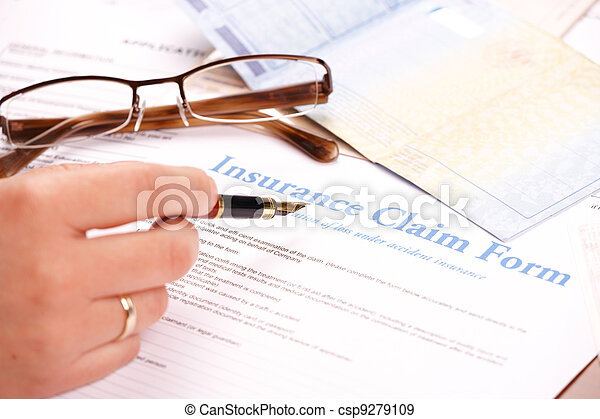 hand filling in insurance claim form - csp9279109