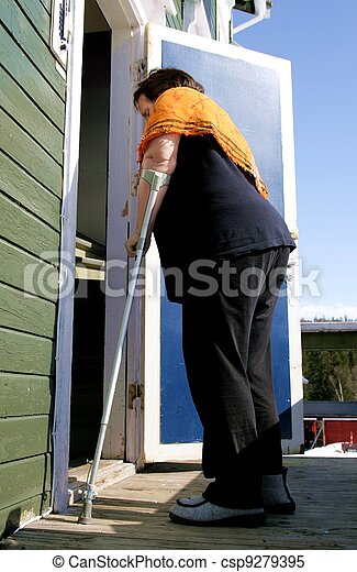 Disabled woman with crutch