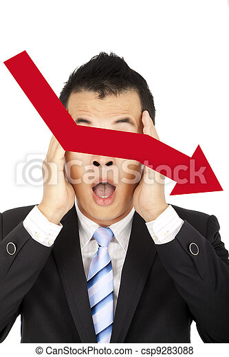 depressed businessman watching the red graph decreasing - csp9283088