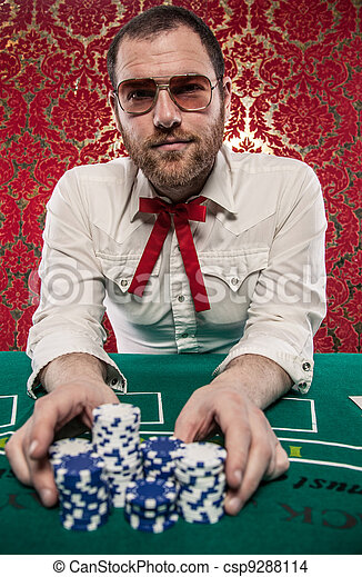 Man Playing Blackjack Bets All - csp9288114