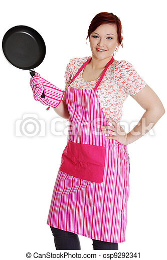 Happy woman in pink kitchen apron. - csp9292341