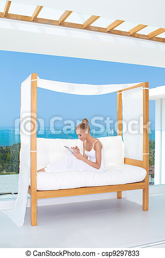 Beautiful woman using a touchpad notebook - csp9297833