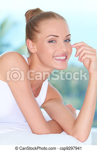 Beautiful high-spirited woman laughing - csp9297941