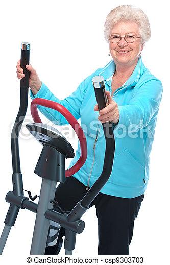 senior woman exercising on stepper - csp9303703