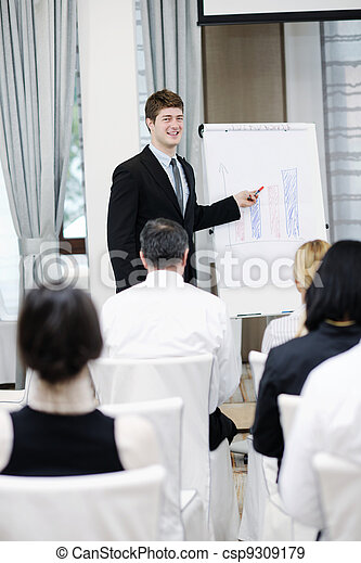 Young  business man giving a presentation on conference - csp9309179
