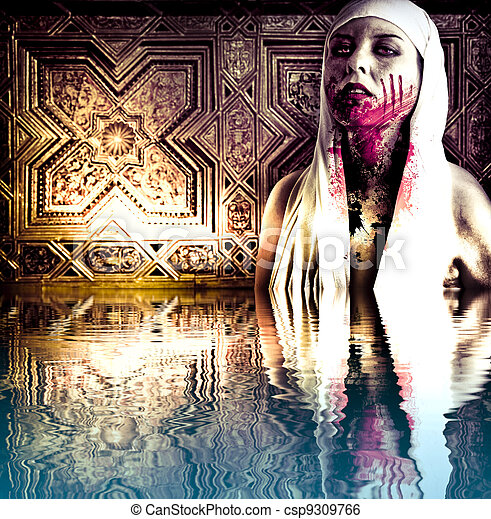 A gory bloody vampire with blood stains. Scary zombie girl  in the water reflection - csp9309766