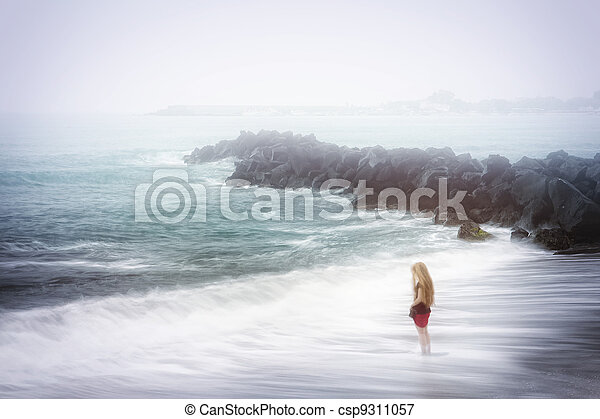 Depression and sadness concept - woman and foggy sea - csp9311057