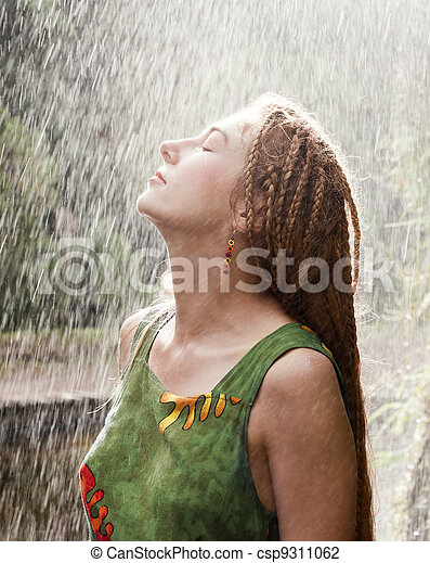 Woman refreshing in the rain - csp9311062