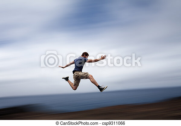 Sport and energy concept - man running fast - csp9311066