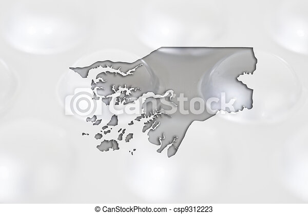 Outline guinea bissau map with transparent background of capsules symbolizing pharmacy and medicine - csp9312223