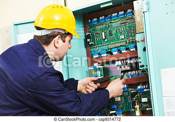 Electrician checking current at power line box - csp9314772