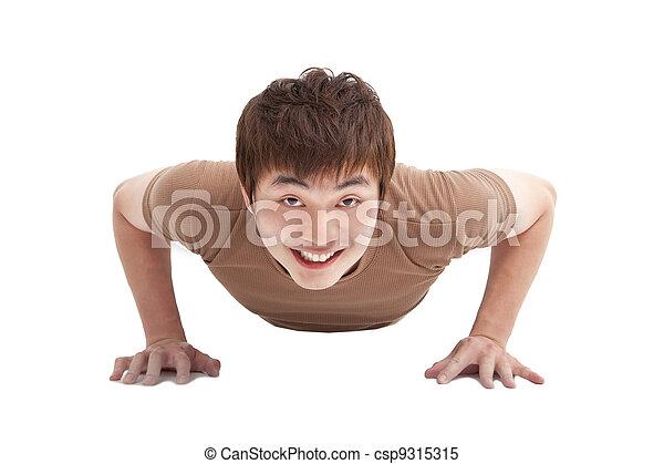 smiling Young man make push-ups  and fitness - csp9315315