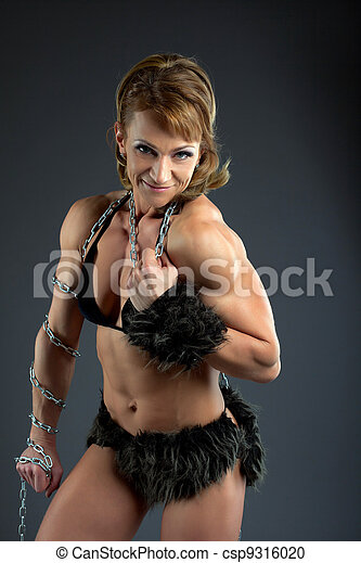 Strong woman body builder smile with chain - csp9316020