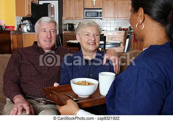 Stock Photo of Home Health Care - Home health care worker and an elderly...