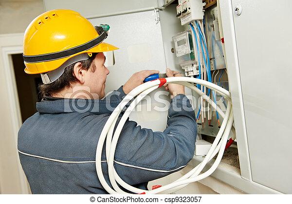 Electrician installing energy saving meter - csp9323057