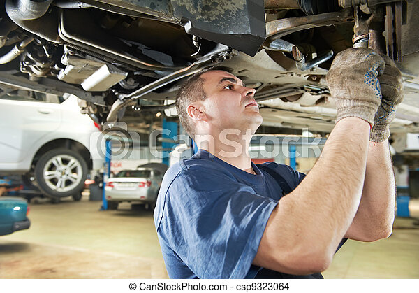 auto mechanic at car suspension repair work - csp9323064