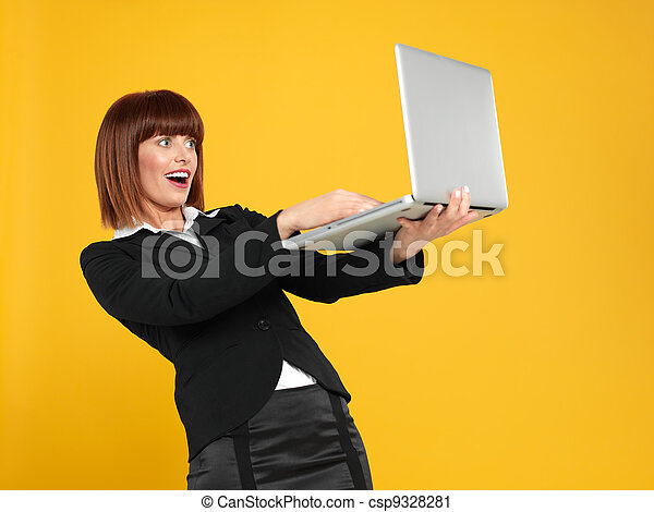 attractive, young businesswoman with surprised face expression - csp9328281