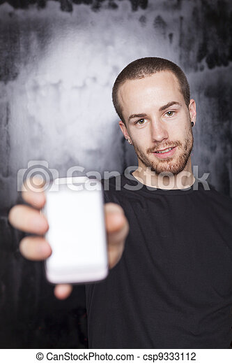 Men showing screen of smart-phone, focus on face - csp9333112