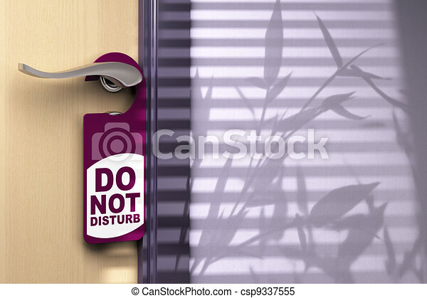 Door handler where its written do not disturb hanged onto a handle color tone is purple there is a wooden door on the left side and room for text at the right side - csp9337555