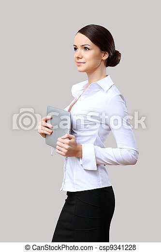 Young beautiful woman in business wear at work - csp9341228