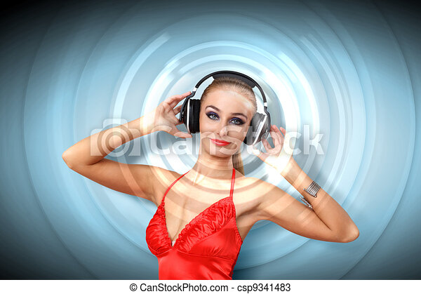Young woman in evening dress with headphones - csp9341483