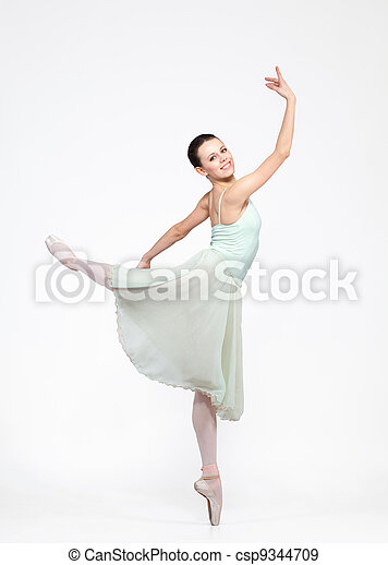 young beautiful ballerina on a gray background - csp9344709