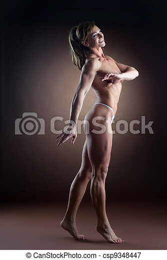 strong woman body builder walk side - csp9348447