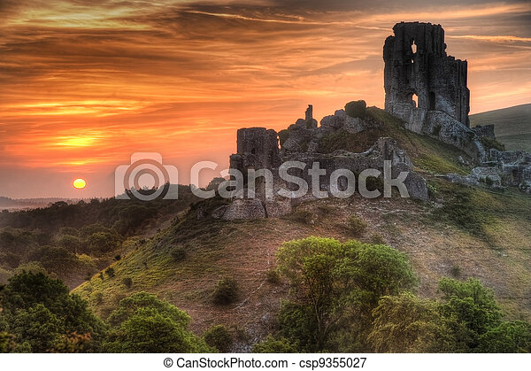 Castle ruins landscape with bright vibrant sunrise - csp9355027
