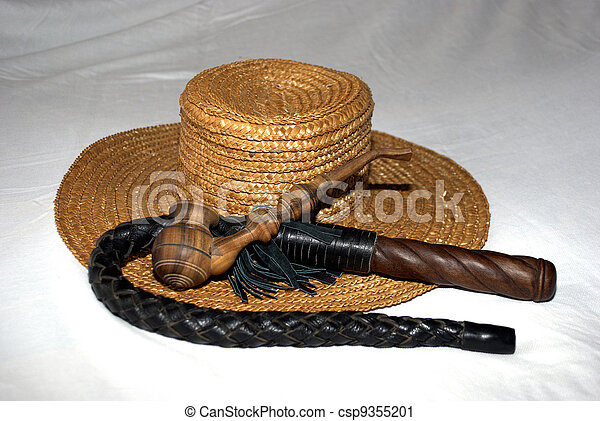 straw hat with a whip and a wooden smoking pipe - csp9355201