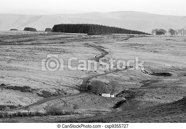 Narrow twisting road over the Mynydd Epynt hills in Wales UK. - csp9355727