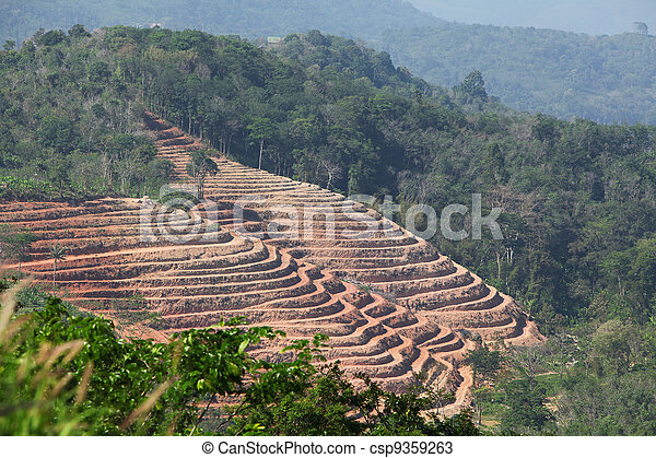 Plowed slope of a hill - csp9359263