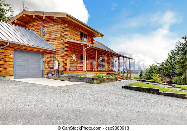 Large log cabin with porch and garage. - csp9360913