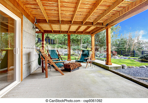 Ground level deck with chairs and door. - csp9361092
