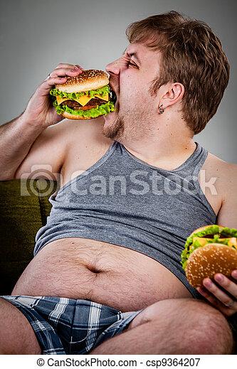 fat man eating hamburger - csp9364207