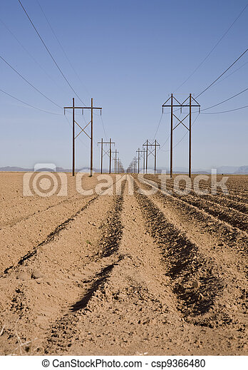 Plowed Field with High-Tension Line - csp9366480