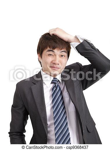 Embarrassment asian businessman - csp9368437