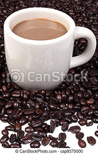 Mug full of hot coffee and beans - csp9370000