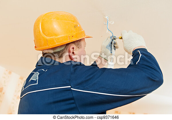 Electrician at cable wiring work - csp9371646