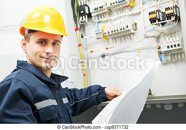 Electrician checking cabling power line - csp9371732