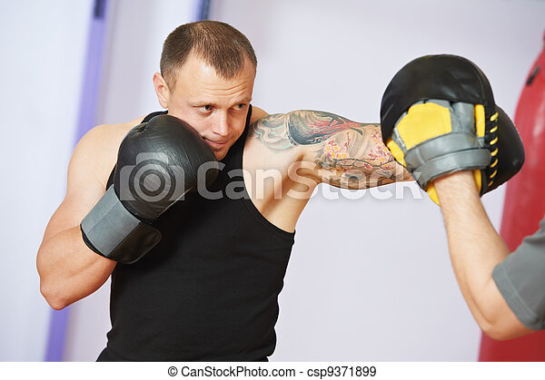 boxer man at boxing training with punch mitts - csp9371899