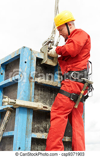 worker mounter at construction site - csp9371903