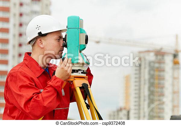 surveyor works with theodolite - csp9372408