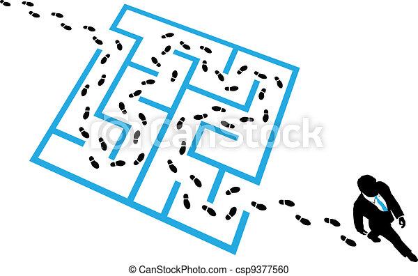 Person solves business problem maze puzzle - csp9377560