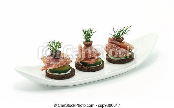Canape with prosciutto and vegetables/ - csp9380617
