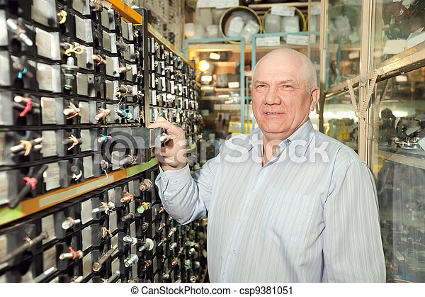 man chooses fasteners in  auto parts store - csp9381051